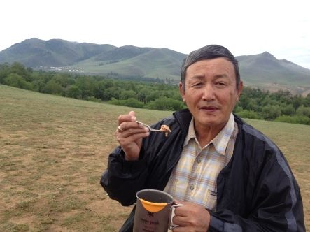 our driver from northern Mongolia! He was down to eat whatever we were eating, although he laughed at the freeze-dried packages. He loved meat!