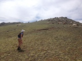 Laurel whispers to mountain goats on our exploration run up and down Yolyn Am's valleys.